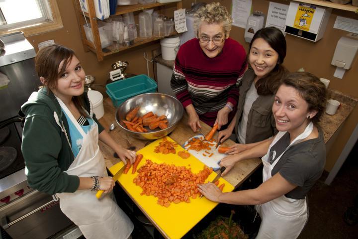 Volunteers work in the kitchen at Sam's Place in Winnipeg, Man. Left to right areSashaHomenko, Anna MarieGiesbrecht,LaeunKin andBirteWiebe.
