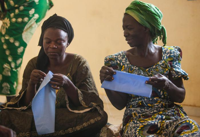 "Sewing is another focus for income generation. Women such as Nendjedjimdaye Celdia and Ilbaiamnodji Victorine hone their skills by making baby clothes to be donated to a local hospital. ""Just as we have received, we are going to give to others,"" says Memadji Tolkoi, who coordinates the income generation programs for CEVIFA. Once women learn to sew, they can use these skills to earn income or to make items for their own family."