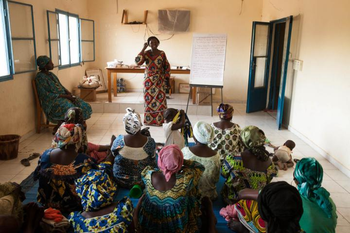 "As CEVIFA's education coordinator, Nodia Almane, center, leads women in discussions about how to implement good health and hygiene practices, even in the midst of challenging environments and obstacles such as living with HIV. ""It's comprehensive,"" Almane says, explaining that her work with the women touches on physical, mental and spiritual health."