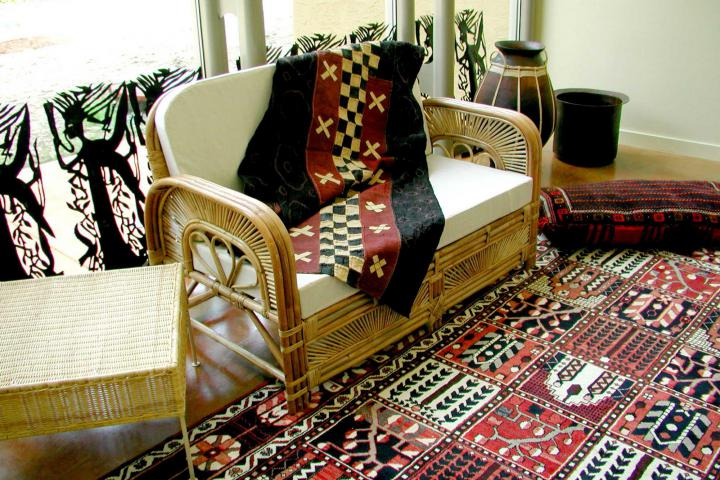Lounge areas in the guest houses and in the lower level of the Meeting Place feature wicker furniture upholstered with fabrics from around the world.