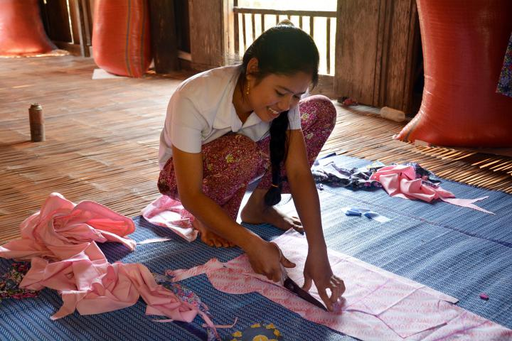 """In Cambodia's Prey Veng Province, some families send their children to work in Phnom Penh or in a neighboring country. MCC supports sewing and tailoring programs at three rural high schools, helping students gain skills they can use to earn a living without leaving home. Chhi Chhinh is among 21 students in the program at her high school. """"I want to learn this skill for my future,"""" she says. Read more about <a href=""""/learn/what/education/globalfamily/reports/2014/spring/sewing-tailoring-vocational-training"""">Chhinh and her determination to start her own business</a>."""