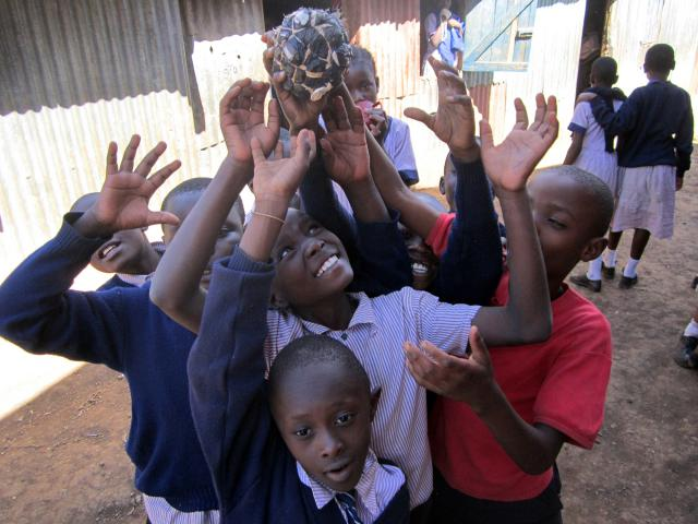 At Menno Kids Academy in Nairobi, Kenya, students play with a ball made of plastic bags. (Make your own by tying a plastic bag into a knot, twisting and tying other bags around it and attaching ends with a rubber band.) Members of Mathare North Mennonite Church, struck by the alarming number of neighborhood children not in school, began the academy to provide low-cost education in this impoverished community.