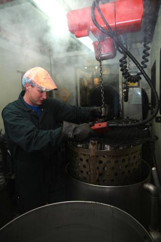 Step 6: The baskets are then placed into a retort, which is a large pressure cooker, where they cook for approximately 135 minutes at 246F with a pressure of approximately 15psi. After the processing is complete, the baskets are cooled using a continuous flow of water until the cans are safe to handle.