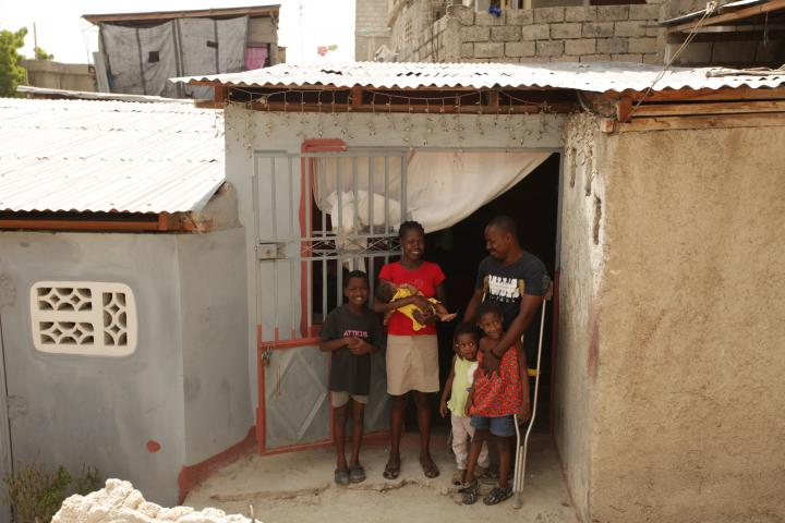 """When I came here, it was an enormous relief."" Verly Boulevard and his family had spent months in a tent camp, the children often sick and his fear for them growing as cholera spread. This home was built in 2011 through an MCC-supported project to repair or construct housing for people with disabilities. Now, Verly has built an extra room onto the house to rent out. ""I said, 'If somebody can come and help me, I need to do what I can to take the next step.'"""