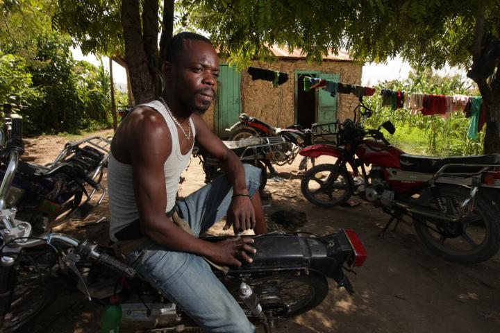 "Thanks to the school's classroom studies and practical training, mechanic Dieunold Sterling can complete complex repair jobs he once would have turned down. Better earnings mean the family eats better. He can get credit to pay school fees. And his dreams have grown beyond fixing bikes in this yard. He'd like to own a full-service garage, employ other graduates and start a parts store. ""I've got a shop here,"" he says, ""but I want to have an enterprise."""
