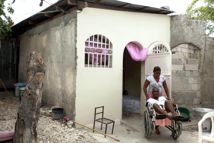 "Marie Antoinette Créa Exumé and daughter Nancy Marc not only had their roof replaced and new plaster put on through this project of MCC, Church World Service and Haitian partners Christian Center for Integrated Development and Service Chretien d'Haiti. They also got a wheelchair ramp. Today Marc can move her mother in or out of the house on her own. ""It changes everything,"" Exumé says. ""Now I'm able to go out. When it's really hot inside, I can go outside."""