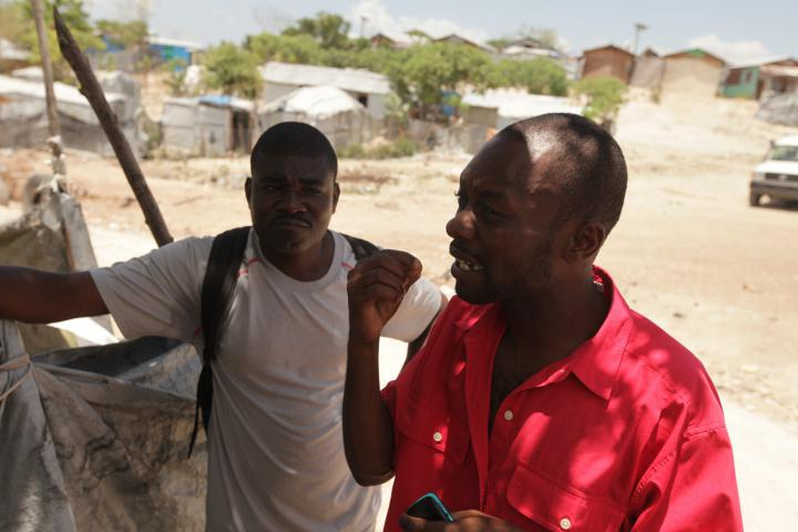 """What we need is houses. It's a right that we have. It's a responsibility of the state,"" says Victor Louinel, right, who has lived in the tent camp of Caradeux since 2010. By working with MCC partner FRAKKA and community organizer Jackson Doliscar, left, he says he's more able to speak up for his rights. ""Before, there were a lot of things people could just do to me that I wouldn't be able to respond in any way,"" he says. (<a href=""http://www.haitihousingdc.org/"">More on housing issues</a>)"