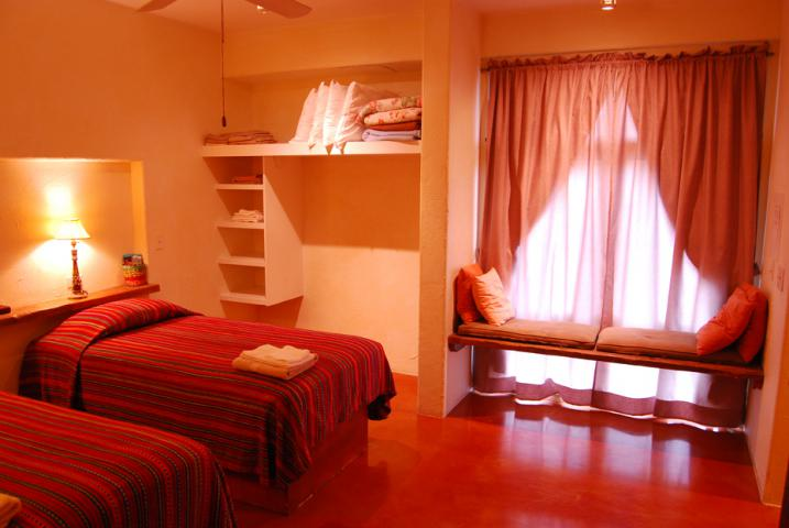 Rooms have either one queen-size bed or two twin beds. The bedrooms have private baths.