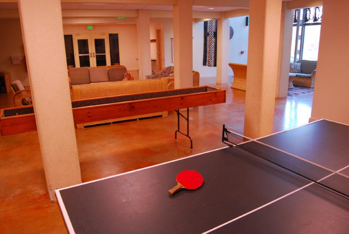The lower level of the Meeting Place includes a ping-pong table, carpet ball table, and informal lounge areas in the foyer outside of the assembly room.