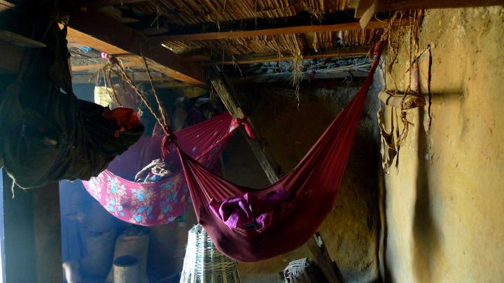 Babies sleeping through the afternoon in hammocks,Yarbang,DhusaVDC,DhadingDistrict. Many homes inrural villages, like this one, are made of mud, stone and timber and easily crumbled in the earthquake. According to our partners, local reports say up to 90 percent of the homes in rural areas were destroyed.
