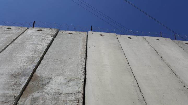 Image: A section of the Israeli separation barrier near Jerusalem, which has cut off a main road that used to be a major artery and severely affected the local economy. MCC photo/Elizabeth Kessler