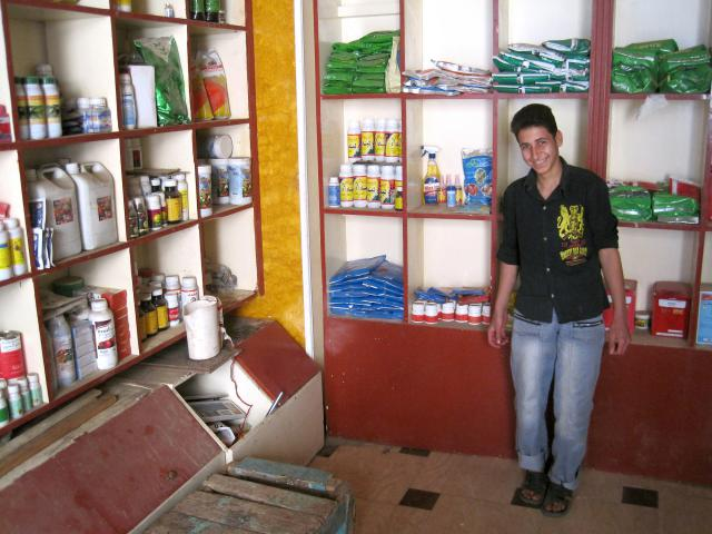 Bola Melad Ragheb, who limps because of polio, stands in the shop where he works after school, earning enough money to pay for his sister's school costs. He credits an MCC Global Family education program with giving him the confidence to apply.