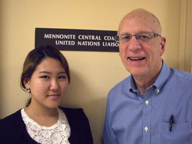 Intern JeaHyun Nham stands with Lynn Roth of Mennonite World Conference at the Mennonite Central Committee United Nations Office where she works.