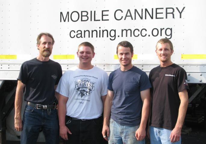 Gerald Heimpel, Toby Penner, Andrew Keeler and Stanley Toews, left to right, are working on the MCC mobile meat canner from October 2013 to April 2014. (MCC Photo/John Hillegass)