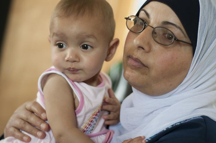 Dalal Duwaik enjoys spending time with granddaughter Nada in the family's new house rebuilt by the Israeli Committee Against House Demolitions.