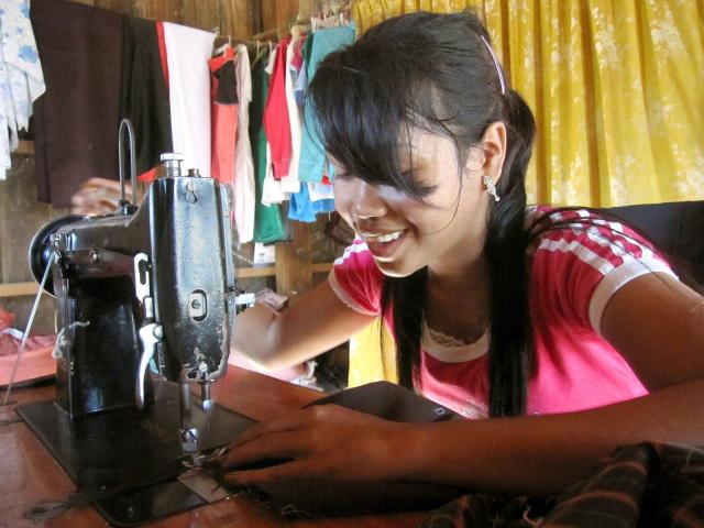 Say Sophal purchased this new sewing machine with help from her older sister to start a tailoring business as a way to support and care for her disabled grandparents. Sophal completed a vocational sewing and tailoring program at Mesang High School in Cambodia. MCC's Global Family education sponsorship program assists the endeavor.
