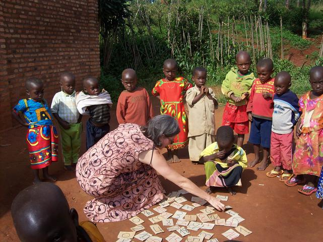 Jodi Mikalachki, former MCC worker in Burundi, helps Gakobwa Bélize, a student in Hope School's preschool, to find the number one on the ground. This activity is indicative of the transition to child-centered activities and away from rote memorization.