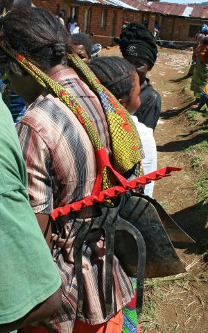 Loading new tools on their backs, women from eastern Congo head to their homes to begin preparing their fields.