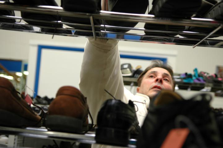 Customer Tony Galetto browses through shoes at the Care and Share Clothing Shoppe in Souderton, Pa.