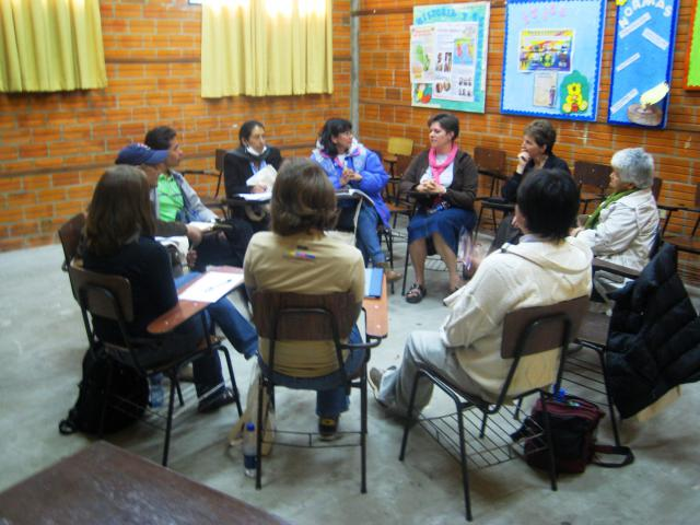 Members of sister churches Stirling Mennonite, Kitchener, Ont., and Villas de Granada, Bogotá, Colombia, introduce themselves to each other at the 2009 Mennonite World Conference general assembly in Paraguay. They met every day to share and discuss what they were learning. Facing each other are Margarita Gil, left, of Colombia, and Pastor Marilyn Rudy-Froese of Ontario. To the left of Gil is Pastor Yalile Cabellero of Colombia. To the right of Rudy-Froese is Josie Winterfeld, of Ontario.