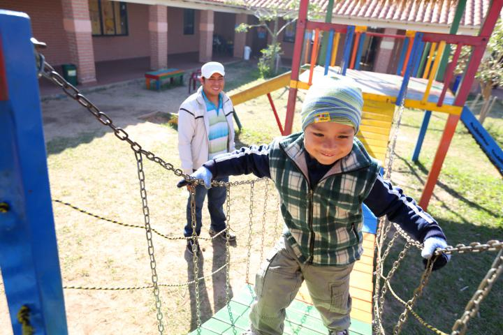Oscar Yoadel, 4, plays at Guarderia Samuelito, his daycare in Santa Cruz, Bolivia, run by the Bolivian Evangelical Mennonite Church, an MCC partner. His father, Oscar Pinto, is a single dad who would not be able to work full-time without the daycare. (MCC photo/Nina Linton)