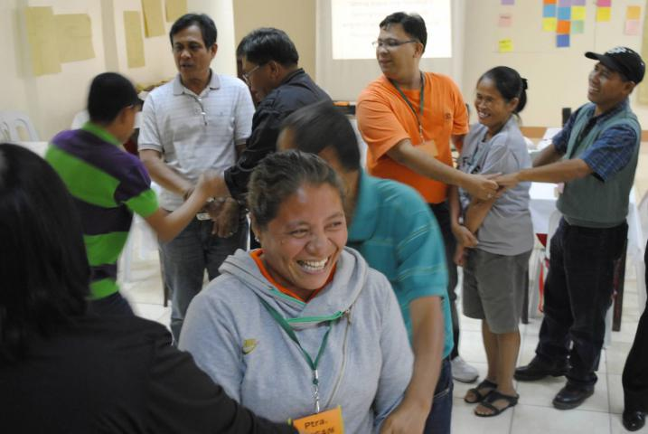 Pastor Jesusa Garba and other Filipino pastors take a break from their intense emotional sharing about Typhoon Haiyan to play a group game together.