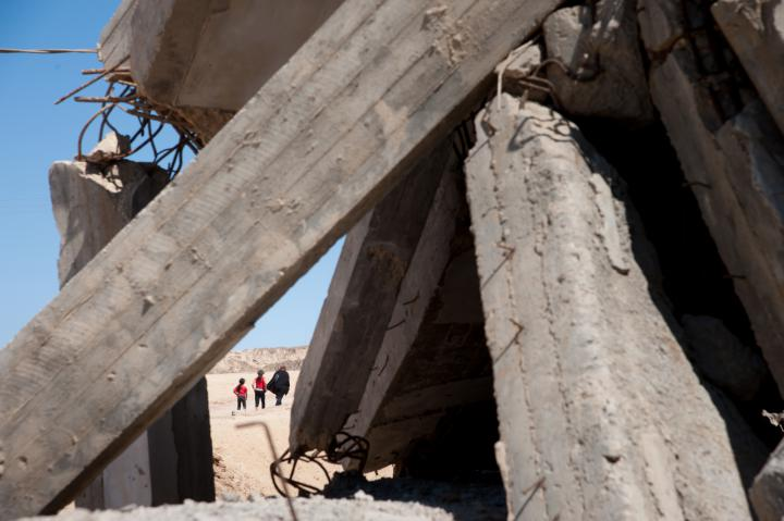 In Beit Lahia, Gaza, on July 4, 2012, Palestinians walk near buildings that have not been rebuilt since the Israeli airstrikes in the 2008-2009 war. Current Israeli airstrikes continue to cause death and destruction in Gaza as Israel and Hamas, the ruling party in the Gaza Strip, launch rockets at each other.