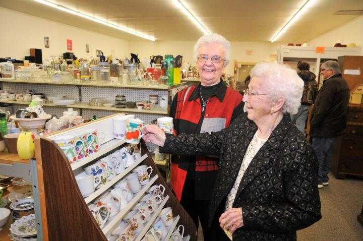 Sara Stoesz, left, and Linie Friesen, in the Altona, Man. MCC thrift shop that they helped start 40 years ago.