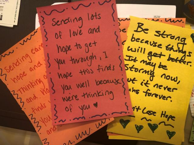 """handwritten letters saying """"sending lots of love and hope"""""""