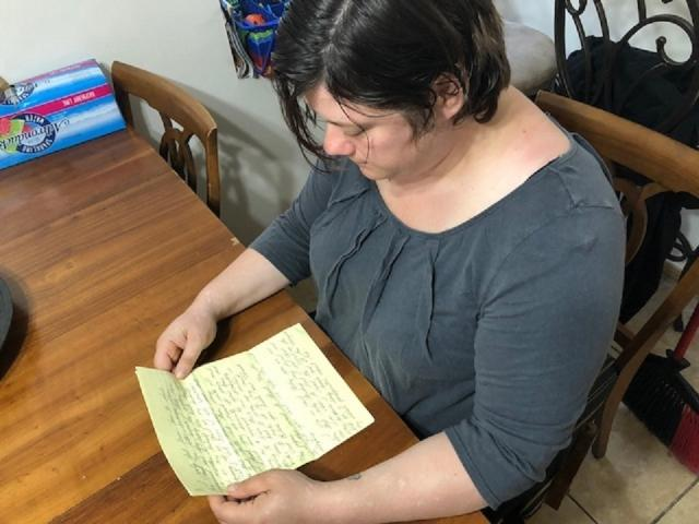 Krista Dutt reading letter