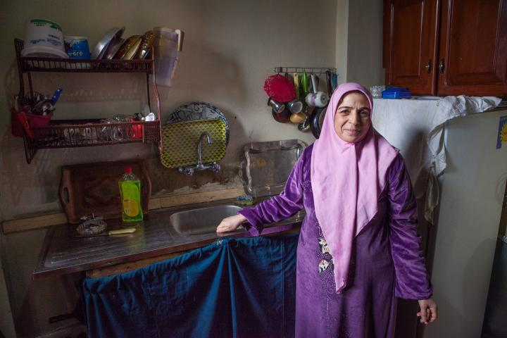Zamzam Ahmad stands by her sink