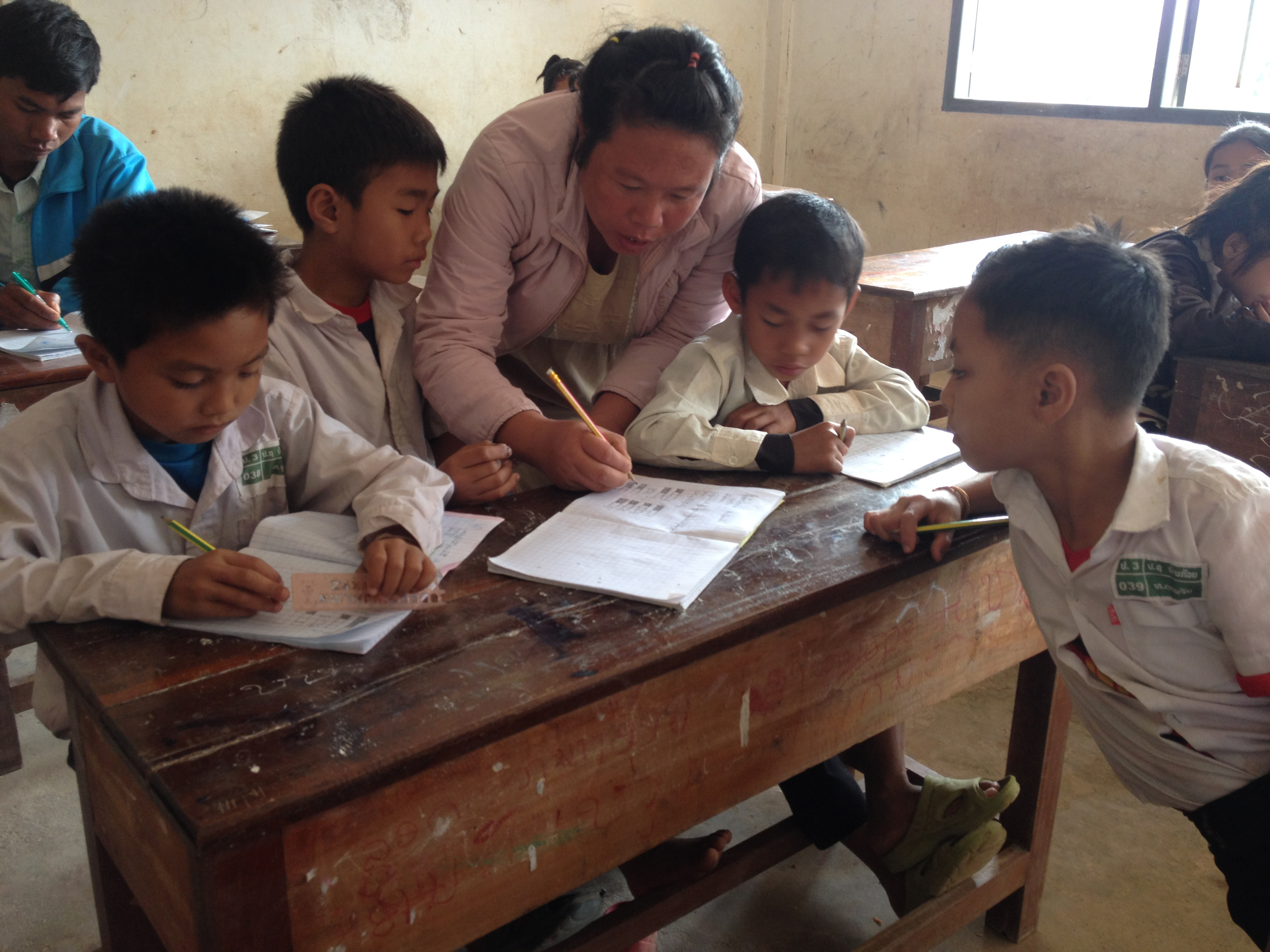 Teacher with her studentslin Laos