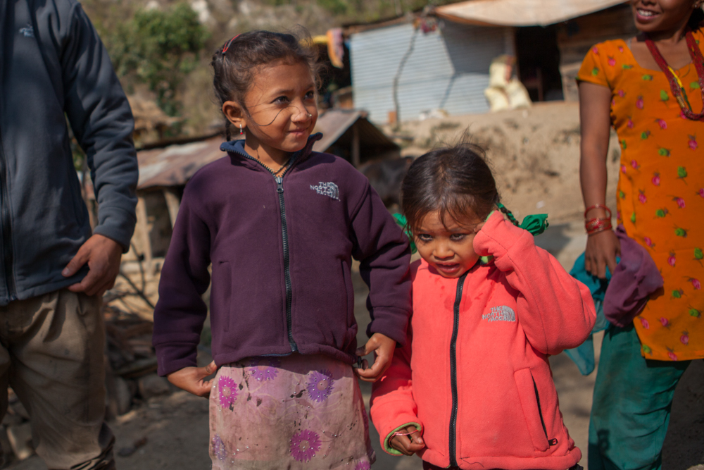 little girls show off their new jackets in Nepal.